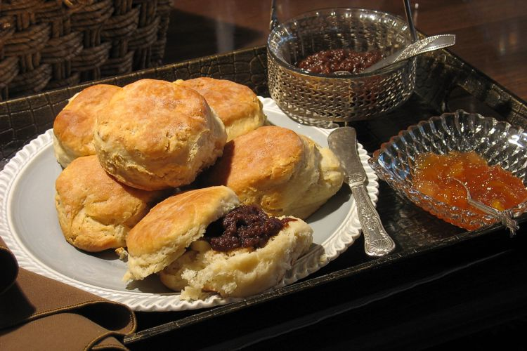 Fresh biscuits with multiple spreads for guest breakfasts.