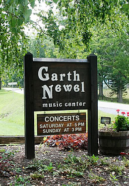 Wooden sign near front entrance of Garth Newel Music Center that shows the name of the center as well as the times of their concerts - Saturday at 5 p.m. and Sunday at 3 p.m.